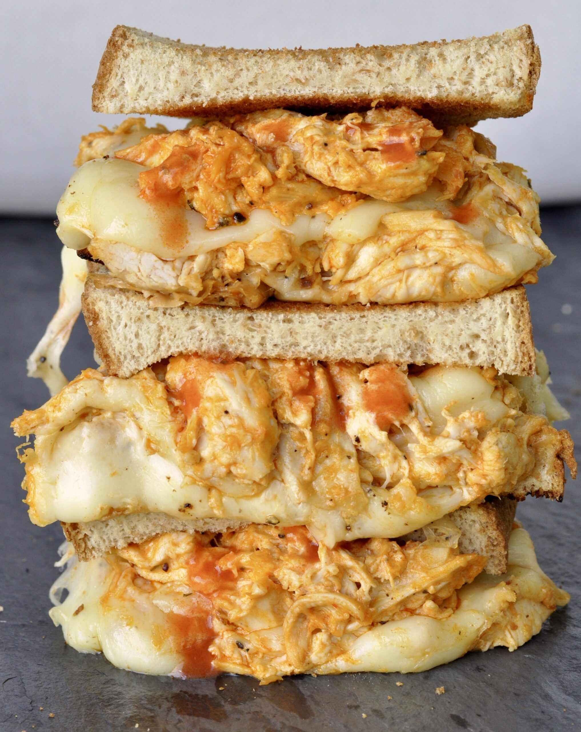 stuffed buffalo chicken grilled cheese halves stacked